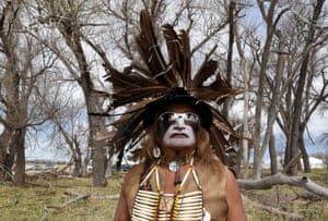 Phil Little Thunder from the Rosebud Reservation wears his ceremonial outfit in the tribal area on the grounds of the Fort Laramie National Historic Site in Fort Laramie, Wyoming. The tribal area was a large field organized into smaller camps according to a tribe, like the Oglala camp, the Rosebud camp and the Cheyenne River camp among others.