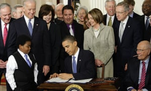 obama signs obamacare