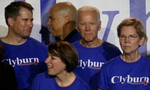 Cory Booker passes Joe Biden at Jim Clyburn's World Famous Fish Fry in Columbia, South Carolina.