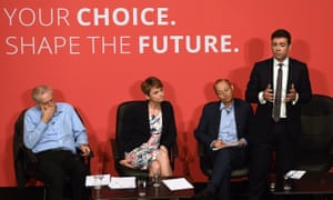 Andy Burnham, standing, speaks at a Labour party leadership hustings in Warrington, with Jeremy Corbyn, left, Yvette Cooper, and journalist Paul Waugh, who was chairing the event. Burnham has refused to say whether his rival Corbyn would get a shadow cabinet post.