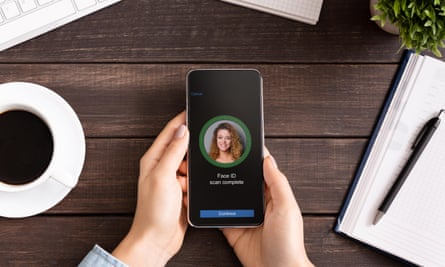 face of a young womans on an iphone face id screen in a home office environment