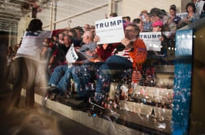 Supporters listen as Republican presidential candidate Donald Trump speaks during a campaign rally in Sumter, South Carolina