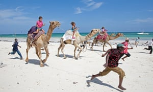 Tourists have returned to Kenya's beaches but are unaware of the death toll in the battle for locals' hearts and minds