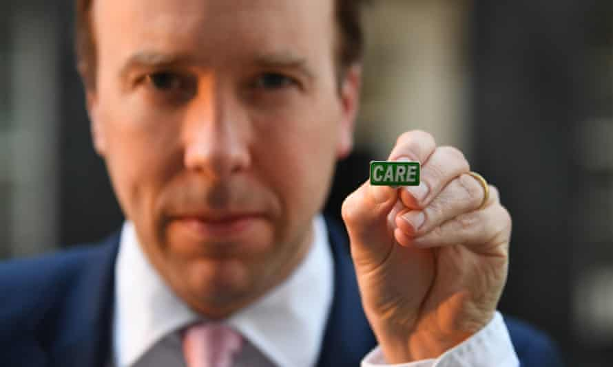 Health Secretary Matt Hancock shows off the new Care badge designed to honour social care workers