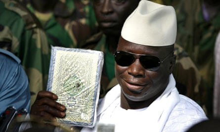 The former president Yahya Jammeh holds up a Qur'an in Banjul in 2006.