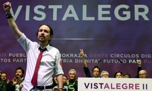 Pablo Iglesias raises a triumphant fist after being re-elected as secretary general of Podemos