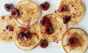Ricotta pancakes with sour cherries, clotted cream and honey.