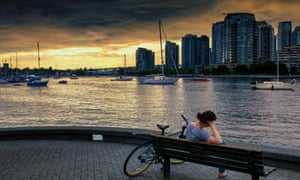 A woman on a bench by a dock