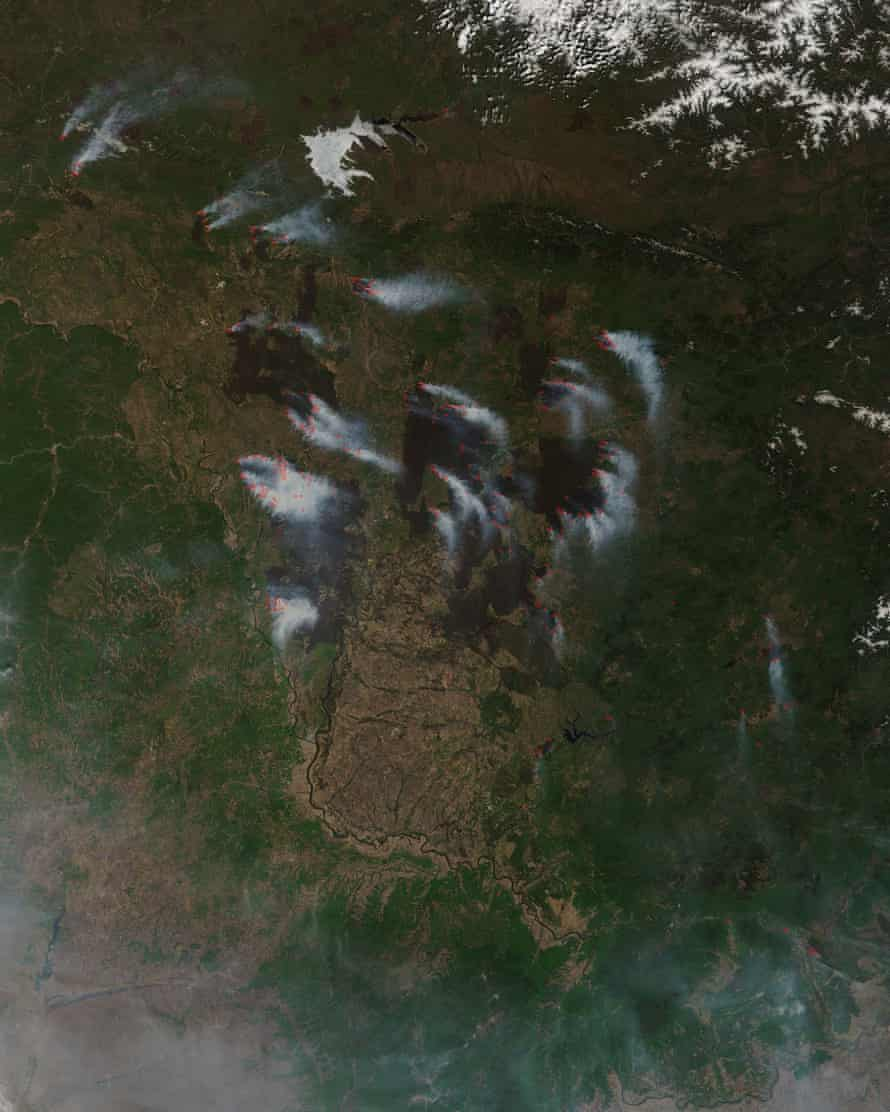 Nasa satellites show wildfires burning in eastern Russia, with red hotspots marking areas of high temperatures.