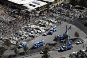 PG&E crews work on restoring power lines in a Santa Rosa neighborhood ravaged by fire in 2017.