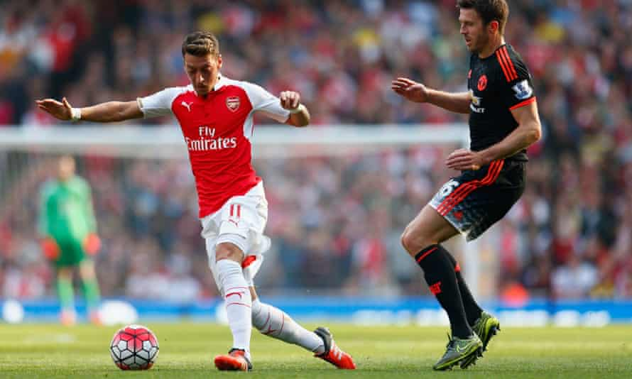 Mesut Özil, left, keeps Michael Carrick of Manchester United at bay during Arsenal's 3-0 win at the Emirates.