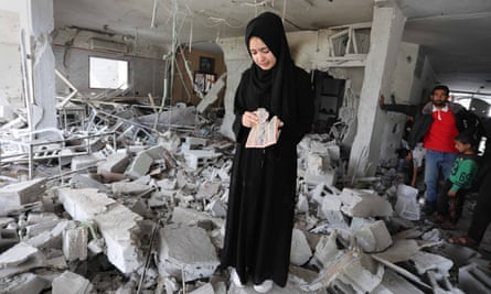 Palestinians inspect the remains of a building following an Israeli airstrike, in the Gaza Strip, this week.
