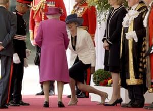 London, England Theresa May curtsies