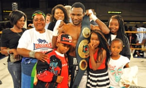 Lovemore N'dou celebrates with his family after his victory over Bongani Mwelase in South Africa in 2010.