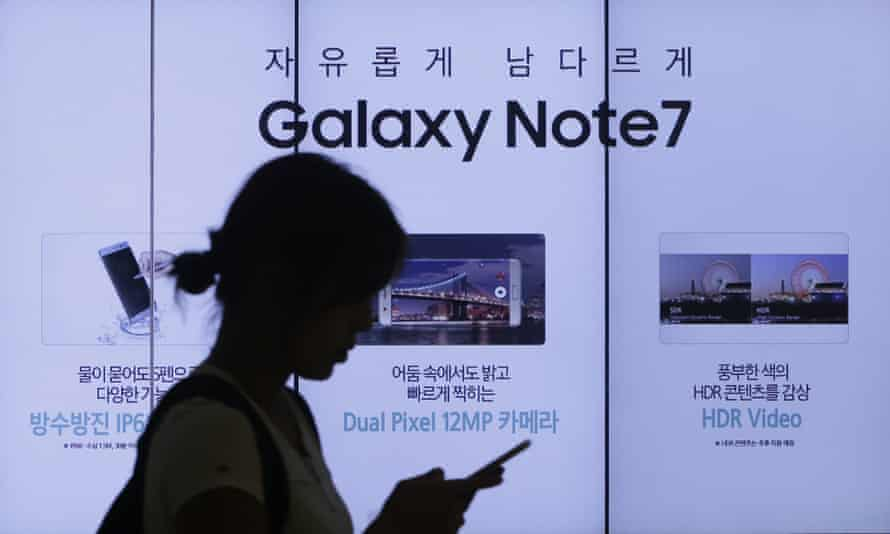 A woman walks by an advertisement of Samsung Electronics Galaxy Note 7 smartphone at the company's showroom in Seoul, South Korea,