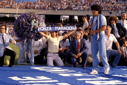 Thousands of Napoli fans greet Maradona in July 1984 at the San Paolo stadium.