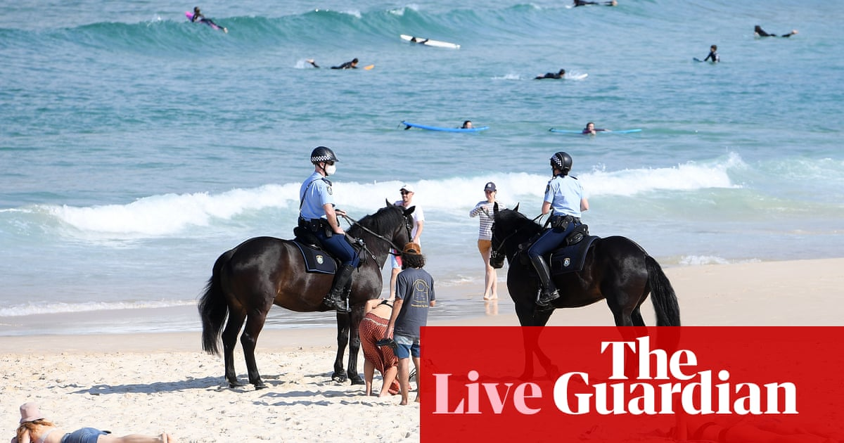 Coronavirus live news: New South Wales goes into lockdown; cost of NHS Covid tests for UK arrivals reduced