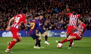Defenders are in disarray as Barcelona's Lionel Messi moves in to score his side's second goal