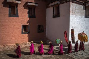 The monks walk in a procession around the monastery