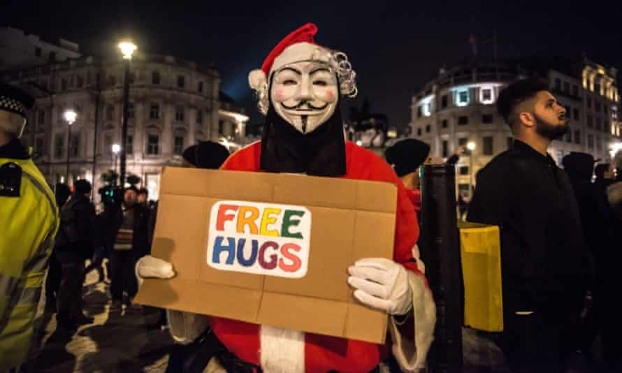 A protester in a Guy Fawkes mask, central London