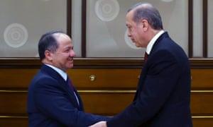 Turkish President Recep Tayyip Erdogan shakes hands with Masoud Barzani, the leader of the Kurdistan regional government in northern Iraq.