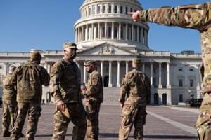 Members of the National Guard patrol outside the US Capitol today.