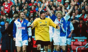 Tim Flowers leads the celebrations as Tim Sherwood and Colin Hendy re-emerge for the presentation ceremony at Anfield.