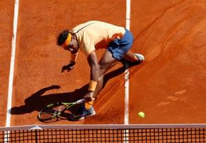 Rafael Nadal stretches to return the ball.