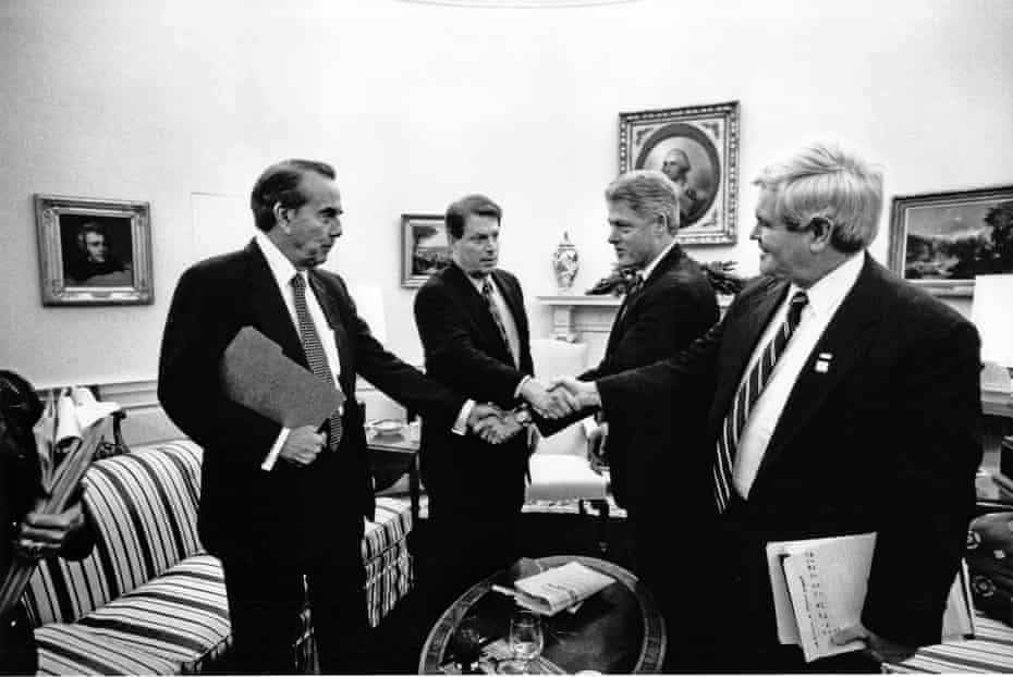 Bob Dole, Al Gore, Bill Clinton and Newt Gingrich, in the White House's Oval Office on 19 December 1995.