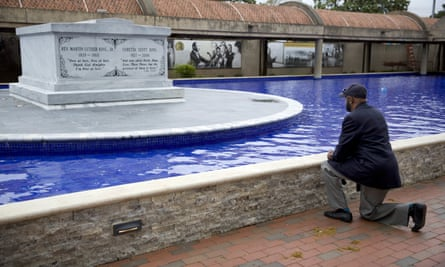 Jeremiah Bridgewater kneels at the gravesite of the Martin Luther King in Atlanta on Wednesday.