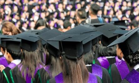 University graduates at a commencement ceremony.