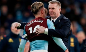 Jack Grealish and Dean Smith embrace