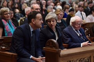 Left to right, the Irish taoiseach, Leo Varadkar, the British prime minister, Theresa May, and the president of Ireland, Michael D Higgins, at the service.