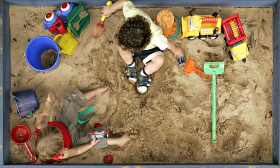 Children play with colourful toys in a sandbox
