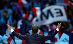 Emmanuel Macron speaks to a packed-out audience at the 20,000-seat Bercy arena.