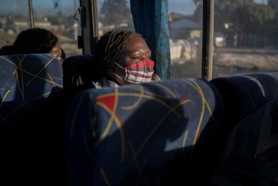 Mupombwi on the bus on her way to work