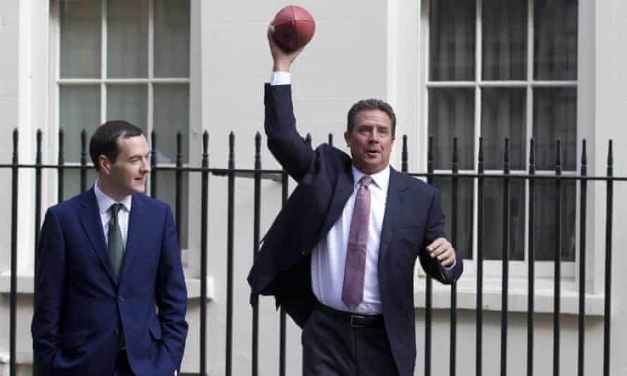George Osborne watches as Miami Dolphins legend Dan Marino throws an American football in Downing Street.