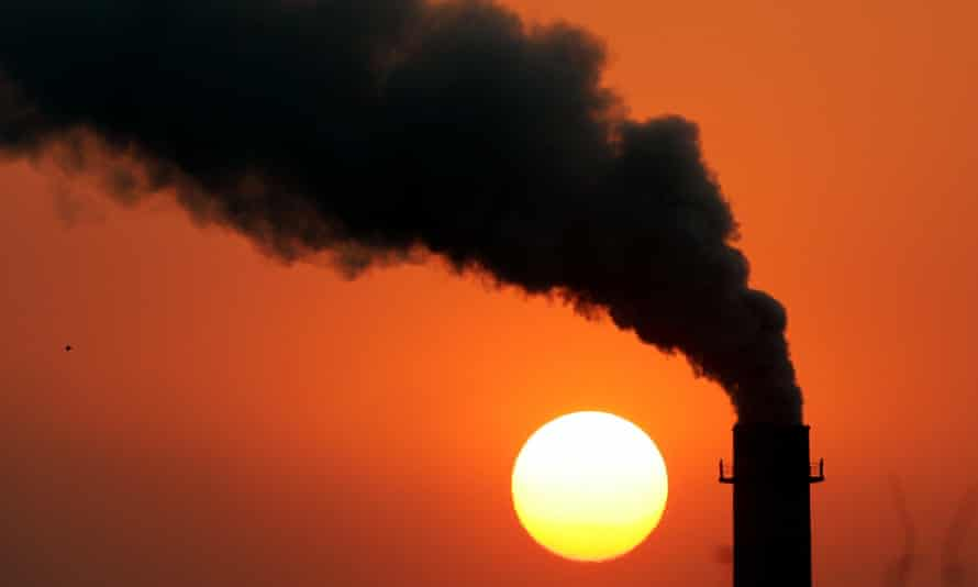 Steam billows from a power station during sunset in New Delhi.