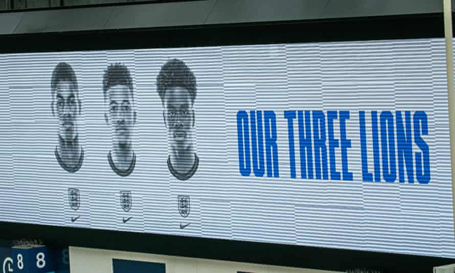 The pictures of England players Marcus Rashford, Jadon Sancho and Bukayo Saka on an electronic board above the concourse at Waterloo station in London.