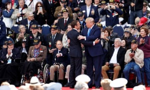 President Donald Trump and French President Emmanuel Macron hug during a ceremony to mark the 75th anniversary of D-Day at the Normandy American Cemetery and Memorial in Colleville-sur-Mer