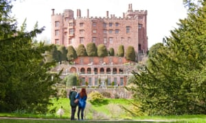 Visitors in the garden at Powis Castle and Garden, Powys, Wales.