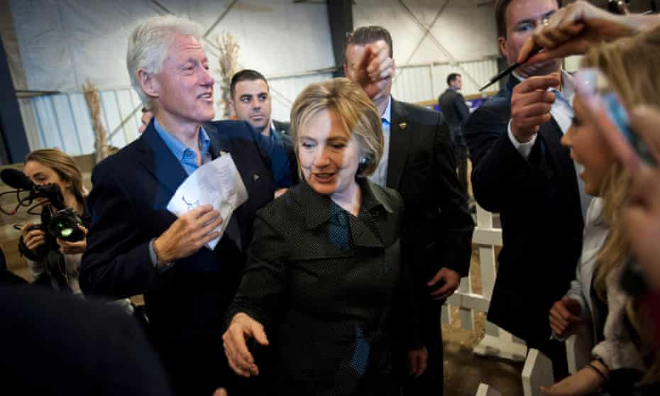 Hillary Clinton and former president Bill Clinton greet supporters in Iowa last year.