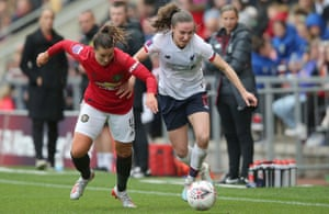 Amy Turner of Manchester United, left, and Niamh Charles of Liverpool battle for the ball during the game at Leigh Sports Village on Sunday.