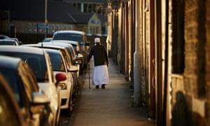 A man walks down a street in Keighley
