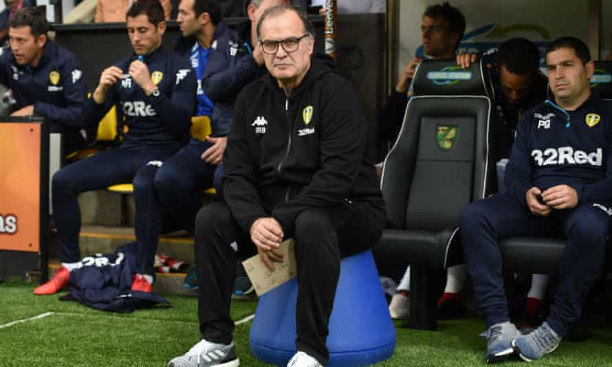 Marcelo Bielsa sits atop his bucket on the Carrow Road touchline