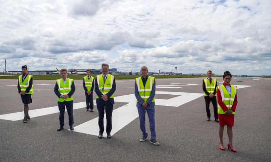 airline bosses and staff standing on a closed runway at heathrow airport