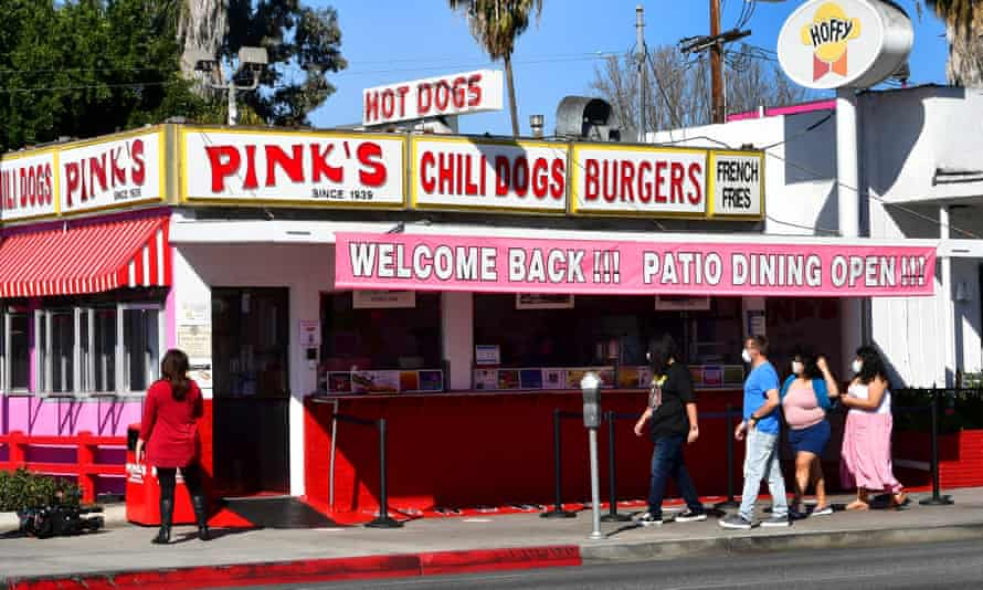 People make their way to Pink's Hot Dogs on the reopening day of the iconic Los Angeles restaurant on 1 March 2021 in California.
