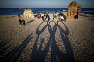 The Olympic rings cast a shadow