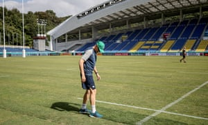 Joe Schmidt inspects the patched up pitch at the Fukuoka Hakatanomori Stadium during the captain's run.