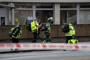 Emergency service workers arrive on the scene close